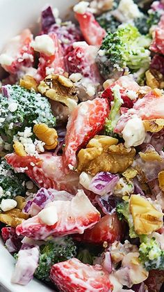Fresh strawberry and broccoli salad with crunchy walnuts, feta cheese, red onions, and a sweet and tangy dressing!