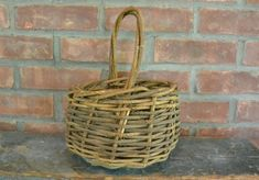 """Vintage Handmade Basket Woven Grapevine with Handle The basket is about tall x Including the handle"""" Very good condition. Use as is as a fruit basket or Dress it up for use as a centerpiece A handsome piece! Vintage Wood, Wicker Baskets, Grape Vines, Primitive, Rustic, Handmade, Farmhouse, Home Decor, Country Primitive"""