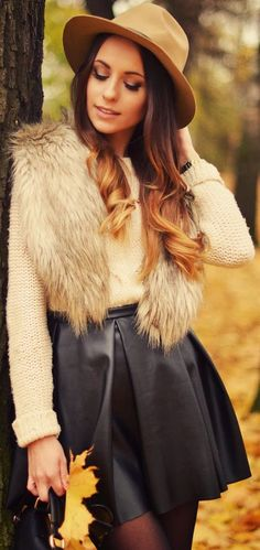 Autumn Fashion Style 2014. Combination of classical hat, fur vest and black leather skirt