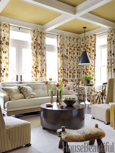 Curtains in Bloomsbury by Lulu DK bring the garden into the family room. Design: Barry Dixon