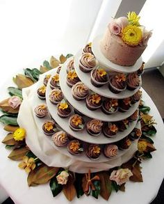 Cupcake tiered wedding cake designs are the modern alternative to modern cake designs. Wedding cupcakes are also considerably cheaper than traditional styles. Cupcake Tier, Cupcake Cakes, Cupcake Ideas, Cup Cakes, Themed Cupcakes, Fun Cupcakes, Fall Wedding Cupcakes, Cupcake Wedding, Wedding Desserts