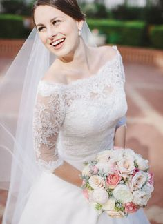 San francisco wedding photography by Clane Gessel Photography.  This bride with her long sleeve gown is STUNNING!