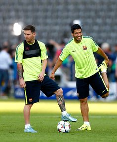 Lionel Messi and Luis Suarez of Barcelona looks on during an FC Barcelona training session on the eve of the UEFA Champions League Final match against Juventus at Olympiastadion on June 5, 2015 in Berlin, Germany.