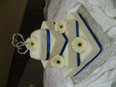 Square wedding cake with crystals and white gerbers