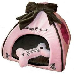 Pet Accessories -- Juicy Couture Pet House.  This is a brand new designer pet house from our collection of Juicy Couture dog accessories.  This chic Pet house is made from Juicy velour with detailing.  Juicy Pet house features signature Juicy hardware and a heart shape mesh window on one end.  House does not come with bone as displayed.