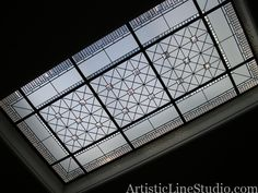 Stained and leaded glass skylight with clear acid, colored  beveled glass and custom made jewels