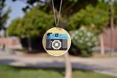 Cross Stitch Wooden Pendant - Diana F. €22,00, via Etsy.