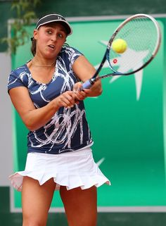 Tamira Paszek of Austria sports a navy and white print, accented with a flirty white skirt.