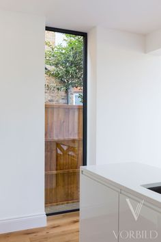 New rear extension to a family house in Surbiton  Featured in:  Ideal Home magazine, August 2017  House Beautiful magazine, April 2017  Houzz Tour: A Light, Bright Kitchen Extension Opens Up a Family Home on Houzz  Houzz Tour Japan  Houzz Japan  SCOPE  A single storey rear extension has been added to a family house in Surbiton.  The new space is light and open.  It contains a new kitchen, dining area and a living room.  Wet underfloor heating allows for an open plan space without having…