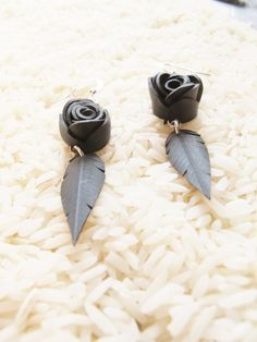 Feather and rose earrings, handmade from recycled bike inner tubes. $24 on Ethical Ocean. #recycle