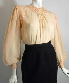 Pale peach silk 1930s blouse with deco topstitch and cutwork design at neckline, openwork down 76d325f6bdc763ab782031ef10e38acf.jpg (496×600)