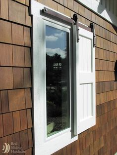 Outdoor sliding window shutter - something a little different.