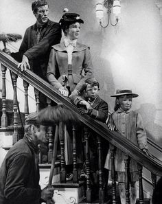 Bert, Mary Poppins, Jane and Michael Banks in the Banks' home after Step In Time.