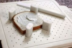 Rheumatoid Arthritis Friendly adjustable cutting board - just stick the pieces around the bread to make buttering bread easier. Autoimmune Arthritis, Rheumatoid Arthritis, Rowan Williams, Gadget, Activities Of Daily Living, Stroke Recovery, Adaptive Equipment, Spinal Cord Injury, Occupational Therapist