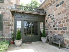 Stone house with green French doors and shutters -- Maus Park (historic home near Toronto), side entrance -- photo: Susan Arness