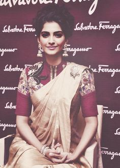 sonam_kapoor_wearing_high_neck_pink_blouse