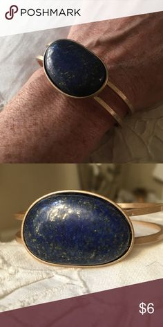 NEW LISTING!! Gold bracelet with blue stone This bracelet is a gold-tone, with a lovely blue stone that also contains flecks of gold. Pull-apart to wear. Jewelry Bracelets