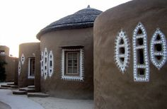 indian cob houses. painting around windows