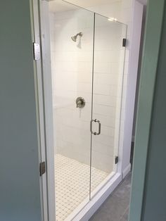 Inline frameless shower with a door that swings in and out and a stationary panel, BM style handle in Brushed Nickel finish Nickel Finish, Furniture, Home Decor, Locker Storage, Storage, Frameless Shower Enclosures, Renovations, Paneling, Bathroom Renovation