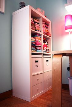 Like the idea of drawers across the bottom and a row of boxes or baskets above that.