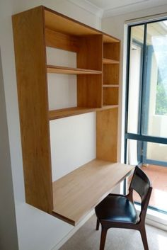 custom made floating plywood desk & shelves