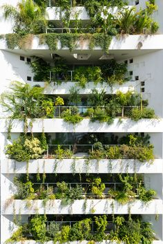 Tower 25 by Jean Nouvel has plants bursting through its walls