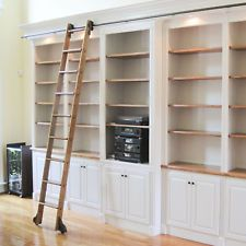 Quiet Glide 9 Ft Red Oak Standard Rolling Ladder with Rail Kit Rail Finish: Bronze, Rail Length: 12 Ft, Mounting Bracket Style: Horizontal Library Ladder, Library Wall, Closet Library, Home Depot, Built In Bookcase, Bookcases, Bookcase With Ladder, Library Bookshelves, Bookcase Wall