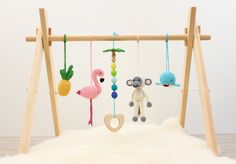 Baby play gym Tropical Adventure. Flamingo, Pineapple, Monkey, Whale, Palm tree. Wooden baby gym frame, crochet baby gym toys, teether by LanaCrocheting on Etsy https://www.etsy.com/listing/533521719/baby-play-gym-tropical-adventure