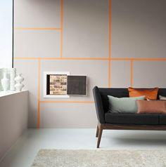 Couleur peinture gris dans salon. Pour la decoration d'un salon design peinture murale gris souris rehaussée par jeu de lignes couleur oran...