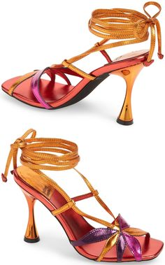 Tapered straps form a lovely flower at the toe of an event-ready sandal lifted by a spool heel and secured with a slender wraparound ankle strap. Embellished Sandals, Studded Sandals, Ankle Strap Sandals, Open Toe Booties, Lace Up Booties, Leather Ankle Boots, Leather Sandals, Balmain Boots, Hiking Fashion