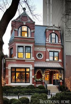A gingerbread-trimmed red-brick Victorian in the heart of the Windy City, Chicago, Illinois...built in 1883 and lovingly renovated in 2010 (in the 1950s, a high-rise was built on one side of the house).  Found on Elegant Chicago Holiday Home | Traditional Home