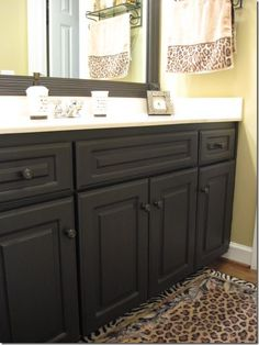 Before and after of bathroom vanity makeover by the - Painting laminate bathroom cabinets ...