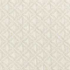 Del Mar Matelasse Outdoor Fabric An exquisite self-patterned outdoor fabric with small scale diamond design, shown in almond. The fabric has a soft, raised surface with a quilted appearance, ideal for outdoor upholstery and cushions with a warm and comfortable feel.
