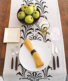 A pretty table runner laid down the length of a table can serve as both decoration and place mats. | A gallery of elegant table-topping ideas to enhance any occasion.