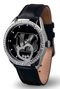 9474678033/947467803334/_B_ This watch is a perfect gift for your favorite sports fan! This beautiful women's watch features the following: Genuine leather strap, Scratch resistant mineral cyrstal len
