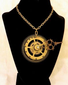 Steampunk Clock Gear Necklace by CodachromeCreations on Etsy  Handmade item Cost: $75 usd Length: 20 - 28 inck inches Materials: Vintage clock parts, Screws and nuts, Jump rings, Rhinestone Ships worldwide from Thousand Oaks, California