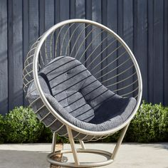 Bubble chair by a black fence in the garden of a Hollywood home, California Bubble Chair, Black Fence, Hollywood Homes, Grey Fabric, Dark Grey, Bubbles, Gray Fabric