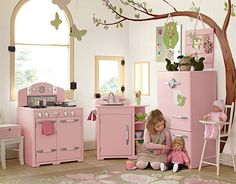 Pottery Barn Kids Pink Retro Kitchen.  Love the painted tree and the butterflies and owls hanging from the walls and ceiling