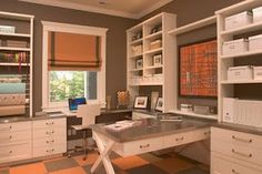 Craft room. I would choose different window treatments and wall art and add additional countertop and work space, but I love all the storage.