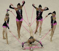 Italian rhythmic gymnastics team performing with ropes during a 2008 competition in Turin