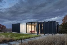 Architecture minimalist in Hudson, NY - United States. Blue Wood and Glass. Hudson Guesthouse and Pool by Janson Goldstein