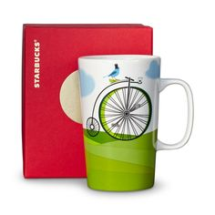 A ceramic coffee mug featuring a big-wheeled bicycle. Part of our Dot Collection.