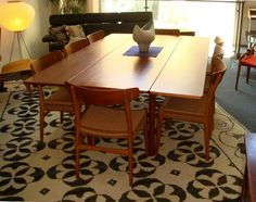 Hans Wegner CH23 dining chairs and teak drop-leaf dining table by Borge Mogensen. Table drop leaves are on the long side rather than the short ends.