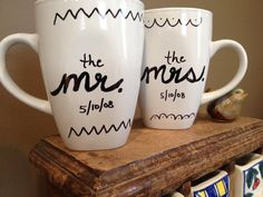 I like these, but I could make 'em myself for less than $4, and certainly less than $10...  Personalized Coffee Mugs Mr & Mrs by AmberLAnderson on Etsy, $10.00