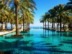Al Bustan Palace Ritz Carlton, one of the best luxury experience in Muscat. Sultanate Of Oman, Muscat, Palace, Adventure, Luxury, Outdoor Decor, Palaces, Adventure Movies, Adventure Books