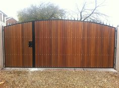 Hand Made, Steel Frame Hardwood Clad Driveway Gates opening 1/2 - 2/3.