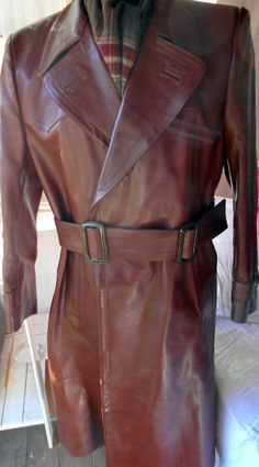 Vintage Faction - VINTAGE GERMAN REDDY BROWN HEAVY HORSEHIDE LEATHER TRENCH COAT UK 40 EU 50, £120.00 (http://www.vintagefaction.com/vintage-german-reddy-brown-heavy-horsehide-leather-trench-coat-uk-40-eu-50/)