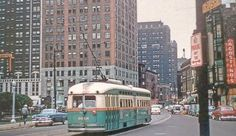 "A ""Green Hornet"" streetcar at the intersection of State, Rush, and Cedar in Chicago sometime in the Notice the Hotel Cedar sign - that building was recently demolished. Chicago Transit Authority, Green Hornet, Chicago Neighborhoods, Rail Car, Chicago Photos, Chicago City, State Street, Gold Coast"