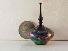 Brian Hart, Hartwood Turning -  multicolor acrylic with brass spirals lidded hollow vase b