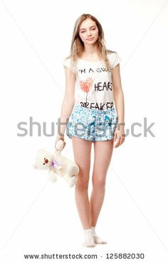stock-photo-beautiful-girl-holding-a-teddy-bear-on-the-side-125882030.jpg (300×470)